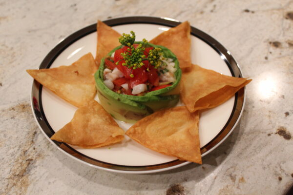 Chips and Guacamole - Homemade flour tortilla chips witha  fress avocado, tomato, cilantro, and lime